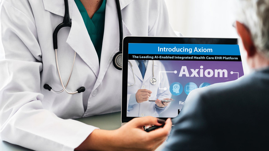 Doctor presenting axiom on computer to patient