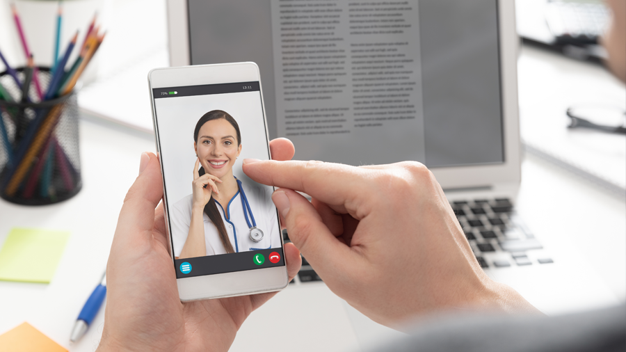 Person on phone with doctor on screen